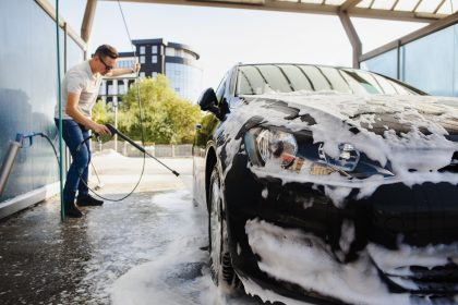 a guy is washing car and car detailing to your car